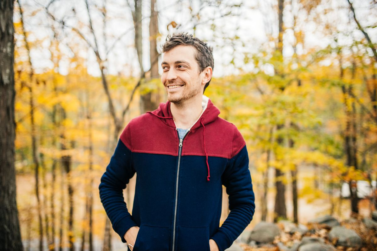 Former Timehop CEO Jonathan Wegener stands in a forest surrounded by yellow leaves.