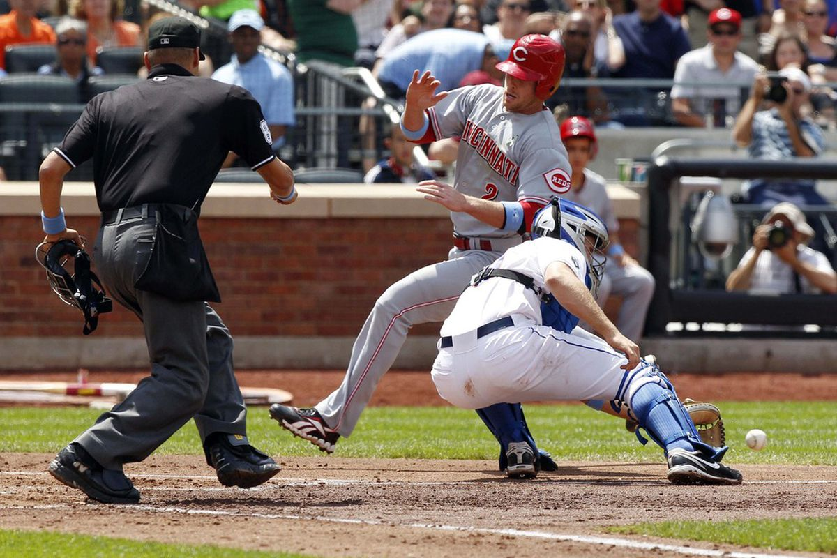 June 17, 2012; Flushing, NY, USA; Cincinnati Reds shortstop Zack Cozart (2) scores a run past New York Mets catcher Josh Thole during the game at Citi Field. Mandatory Credit: William Perlman/THE STAR-LEDGER via US PRESSWIRE