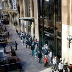 People line up on Main Street for the grand opening of the City Creek Center in Salt Lake City on Thursday, March 22, 2012.