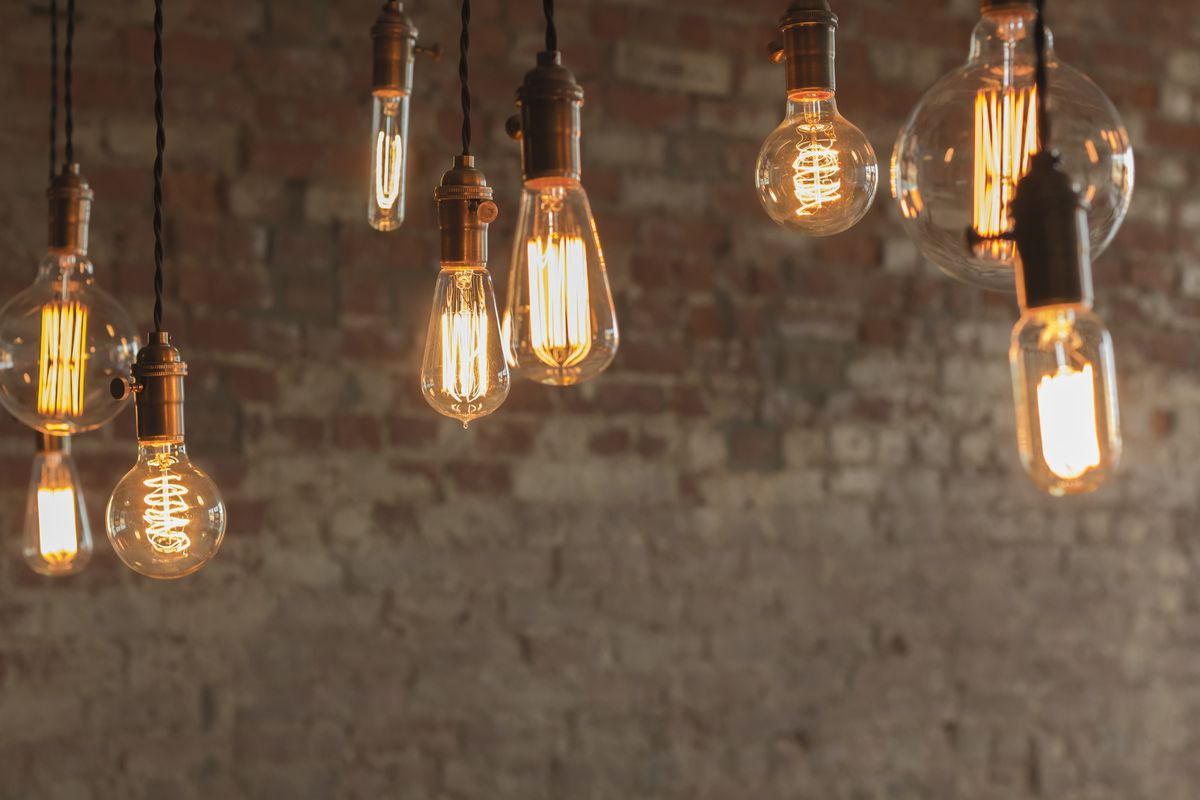 a series of hanging lightbulbs attached to cords.