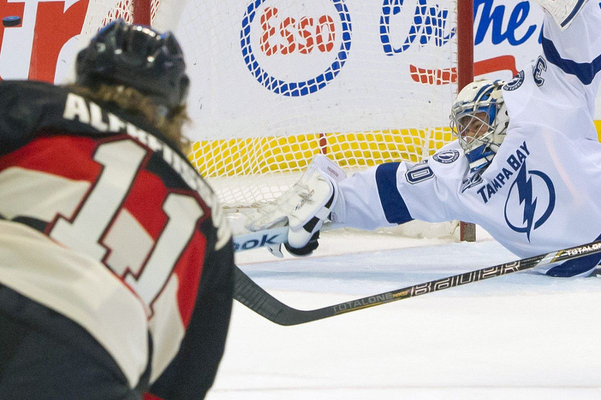 Mar 23, 2013; Ottawa, ON, CAN; Tampa Bay Lightning goalie Cedrick Desjardins makes a save on a shot from Ottawa Senators right wing Daniel Alfredsson (11) in the second period at Scotiabank Place.
