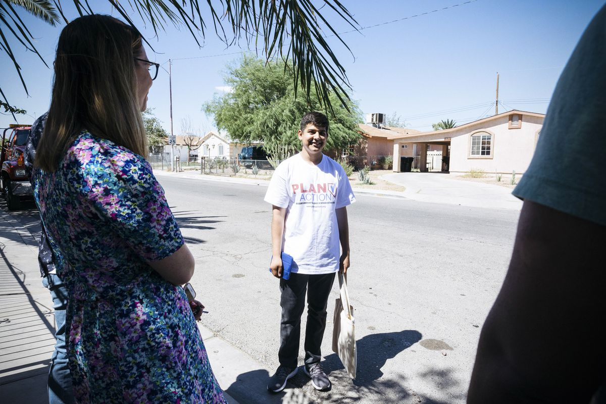 Right, Steven Camacho, 16, speaks with his team while canvassing a neighborhood with PLAN Action in Las Vegas, Nev. on September 15, 2018.