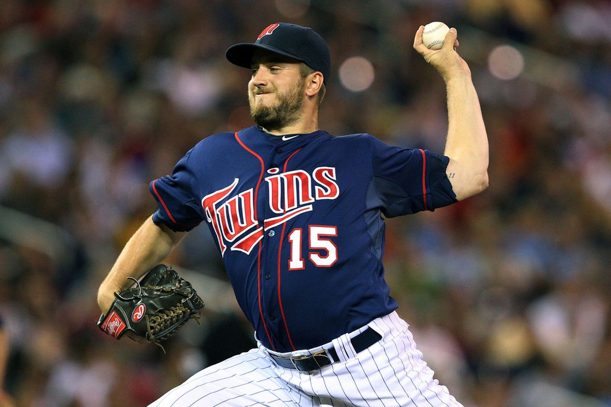 June 25, 2012; Minneapolis, MN, USA: Minnesota Twins relief pitcher Glen Perkins (15) delivers a pitch in the eighth inning against the Chicago White Sox at Target Field. The Twins won 4-1.  Mandatory Credit: Jesse Johnson-US PRESSWIRE