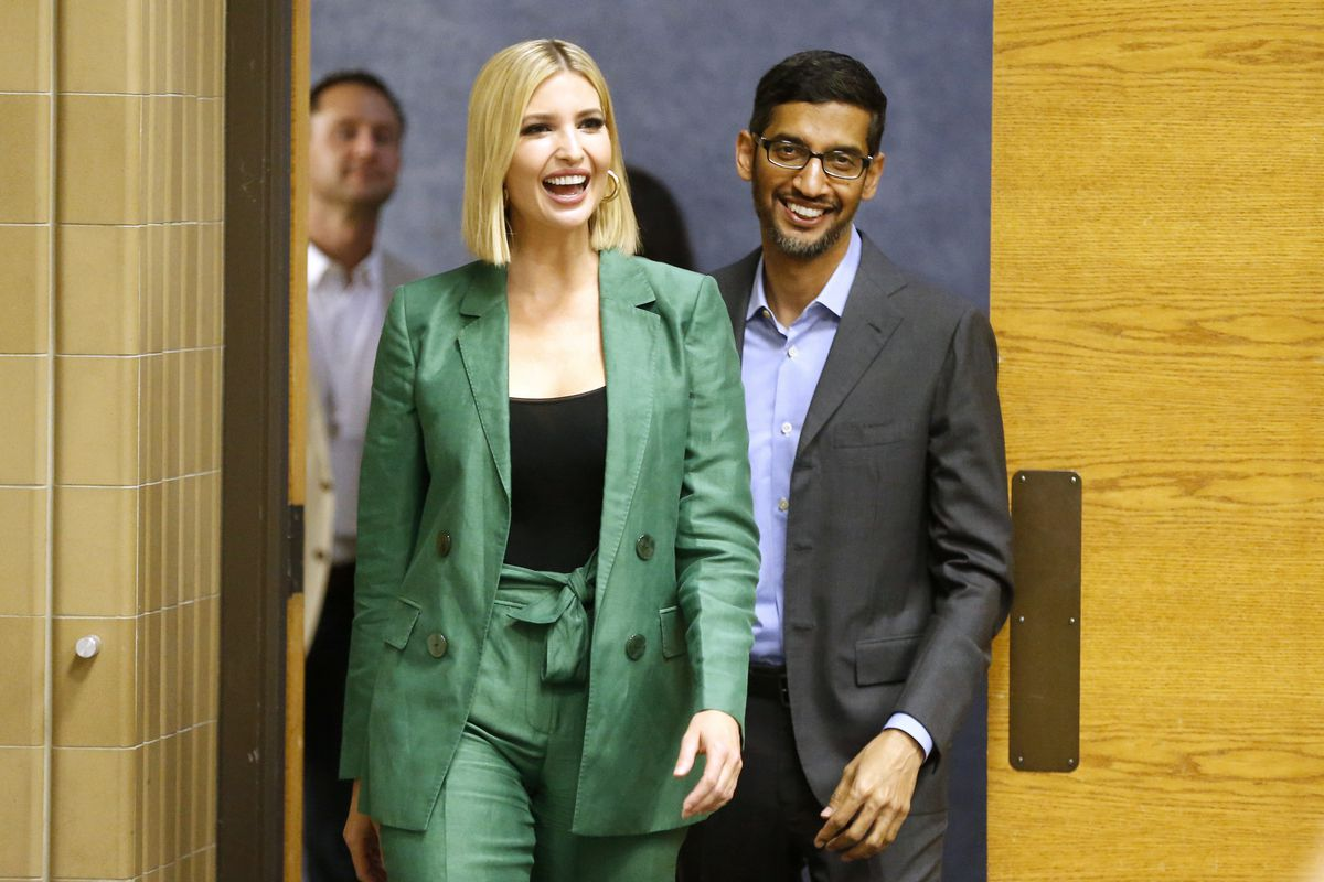 Ivanka Trump and Google CEO Sundar Pichai walking into a room together and smiling.