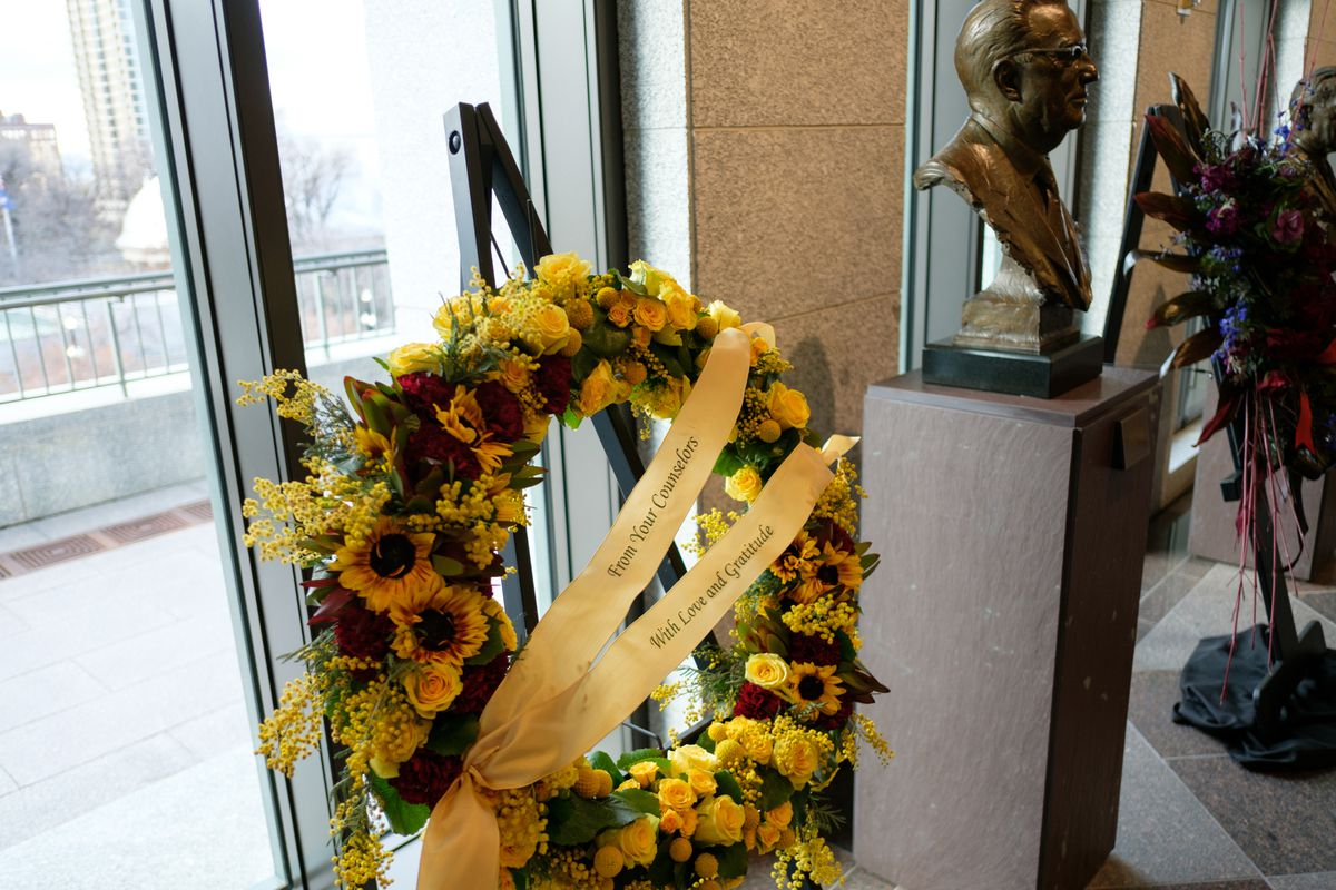 A wreath from LDS Church President Thomas S. Monson's counselors is pictured during his viewing at the Conference Center in Salt Lake City on Thursday, Jan. 11, 2018.