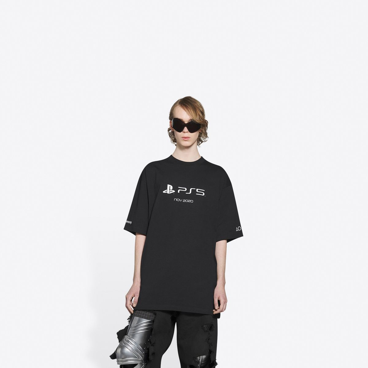 A person modeling a very expensive black PS5 T-shirt