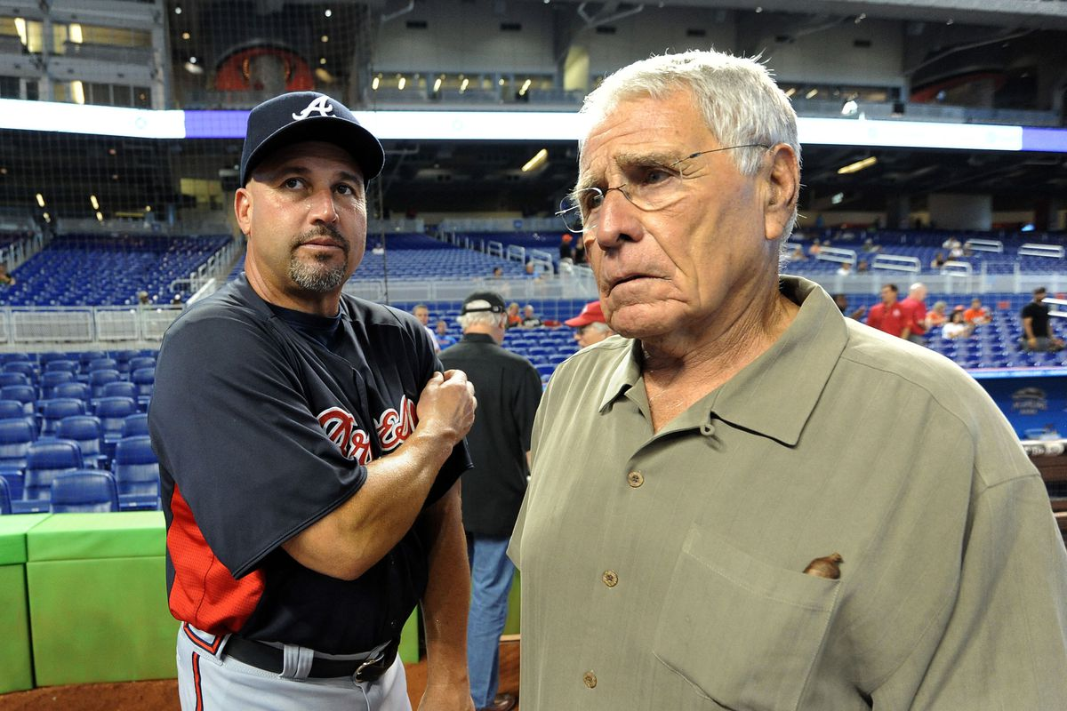 July 24, 2012; Miami, FL, USA; Atlanta Braves manager Fredi Gonzalez (left) talks with former Florida Marlins manager Jack McKeon (right) before a game at Marlins Park. Mandatory Credit: Steve Mitchell-US PRESSWIRE