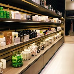 As for the spa, it's sort of like what a beach bungalow in heaven would look like. The spa shop is like the lobby's gift shop, only with rows of perfectly organized creams, scents and candles and a dedicated section for fitness apparel.