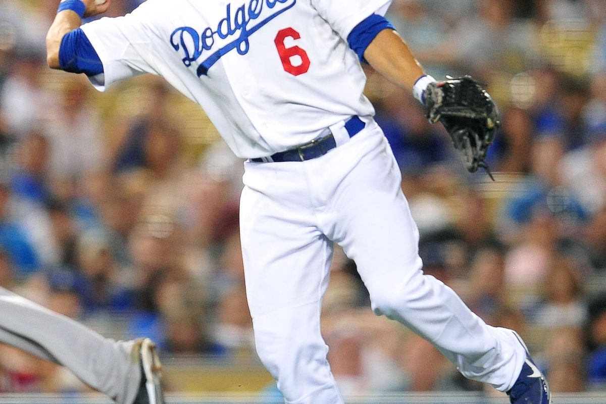 August 7, 2012; Los Angeles, CA, USA; Los Angeles Dodgers second baseman Jerry Hairston Jr. (6) throws to first for an out in the seventh inning against the Colorado Rockies at Dodger Stadium.  Mandatory Credit: Gary A. Vasquez-US PRESSWIRE
