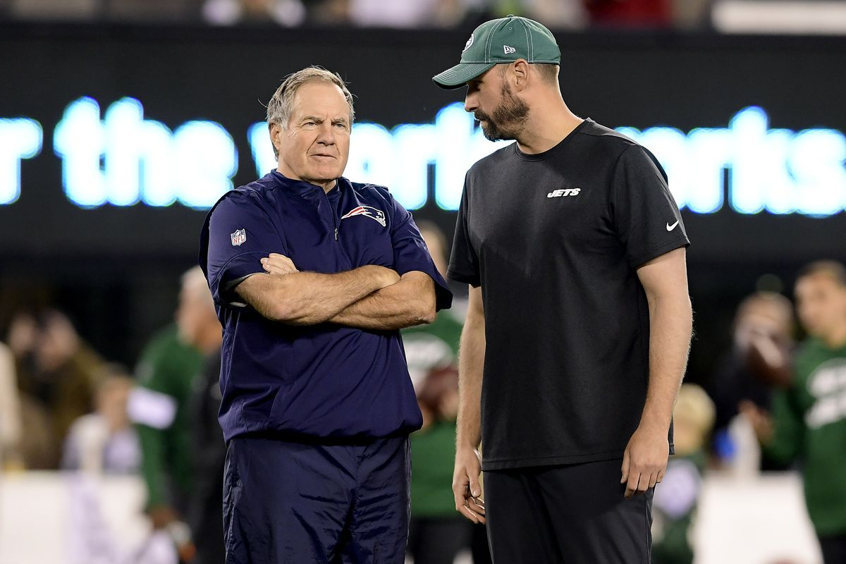 Head coach Bill Belichick of the New England Patriots and head coach Adam Gase of the New York Jets speak prior to the game at MetLife Stadium on October 21, 2019 in East Rutherford, New Jersey.