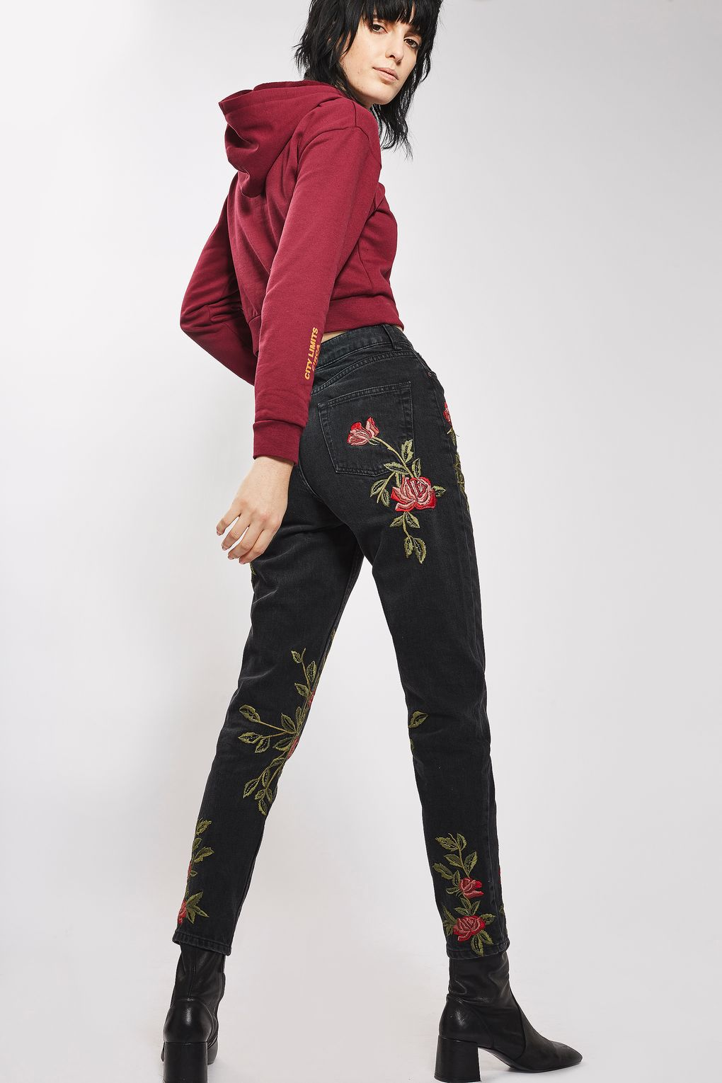 black jeans embroidered with roses