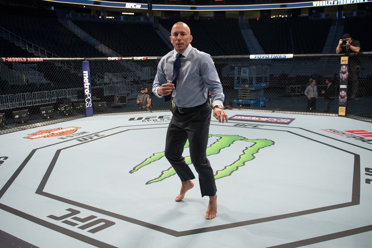 Georges St-Pierre warms up in the Octagon ahead of UFC 217.