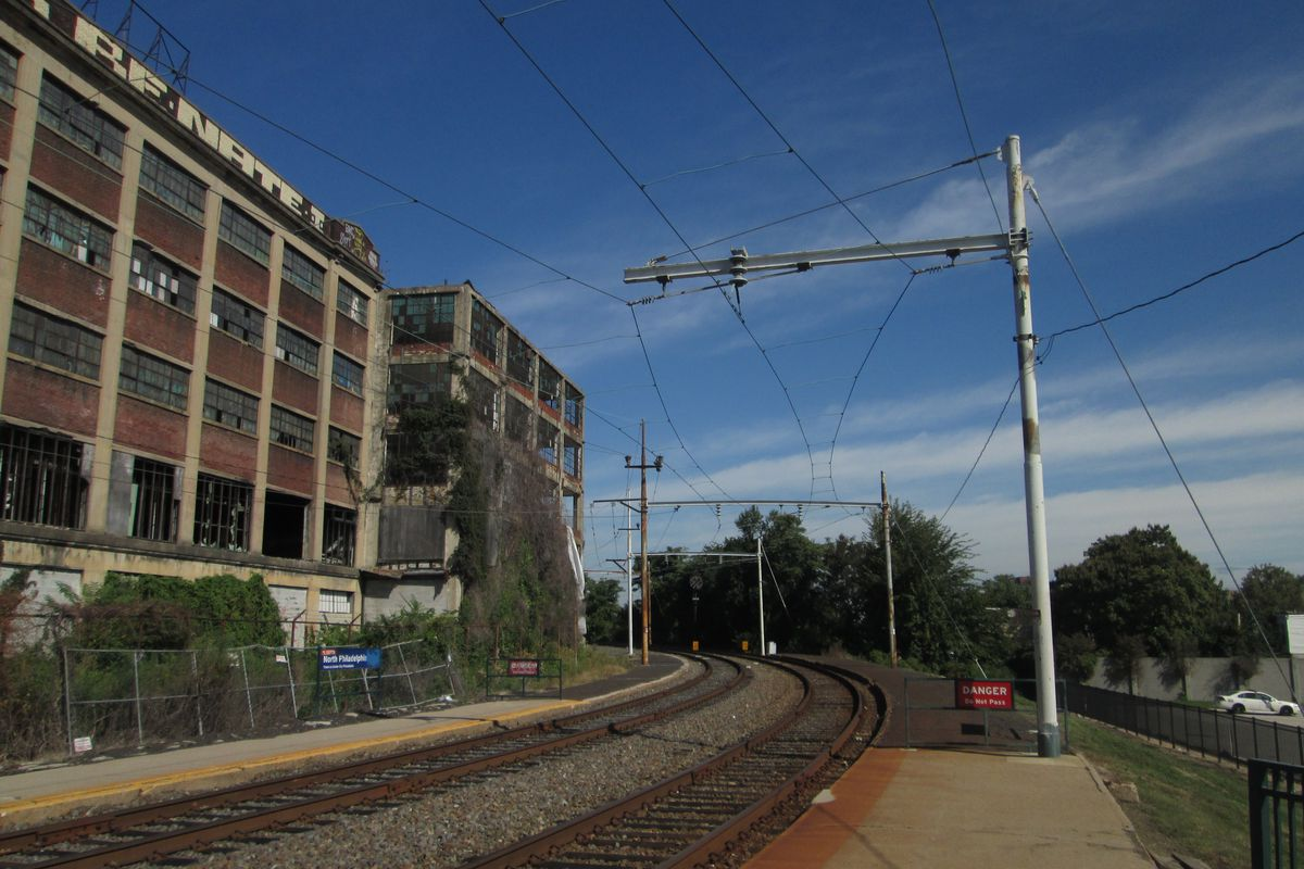 An abandoned warehouse sits next to the North Philadelphia Station rail line.