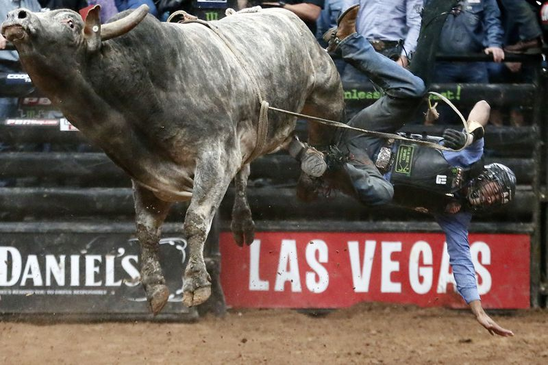 Bull rider Alisson De Souza gets bucked from bull Short Pop during the PBR Unleash the Beast competition.
