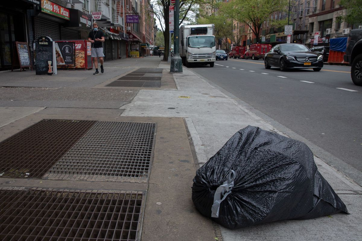 A lone bag of garbage waits for pickup on West 14th Street in Manhattan, which has seen a sharp reduction in refuse during the coronavirus outbreak.