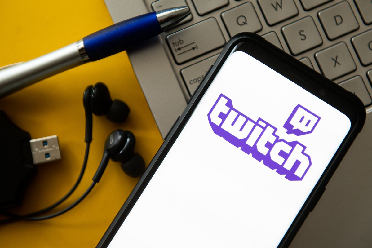 In this photo illustration a Twitch logo seen displayed on a smartphone.