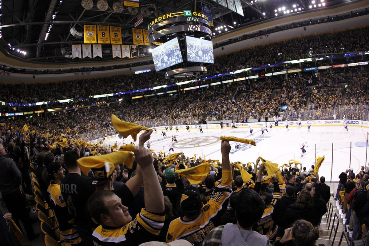 April 12, 2012; Boston, MA, USA; Fans cheer during the first period in game one of the 2012 Eastern Conference quarterfinals between the Washington Capitals and the Boston Bruins at TD Garden.  Mandatory Credit: Greg M. Cooper-US PRESSWIRE