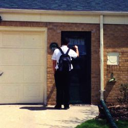 Greg Trimble is shown here knocking on a door as an LDS missionary. He said serving a mission in Michigan was a life-changing experience.