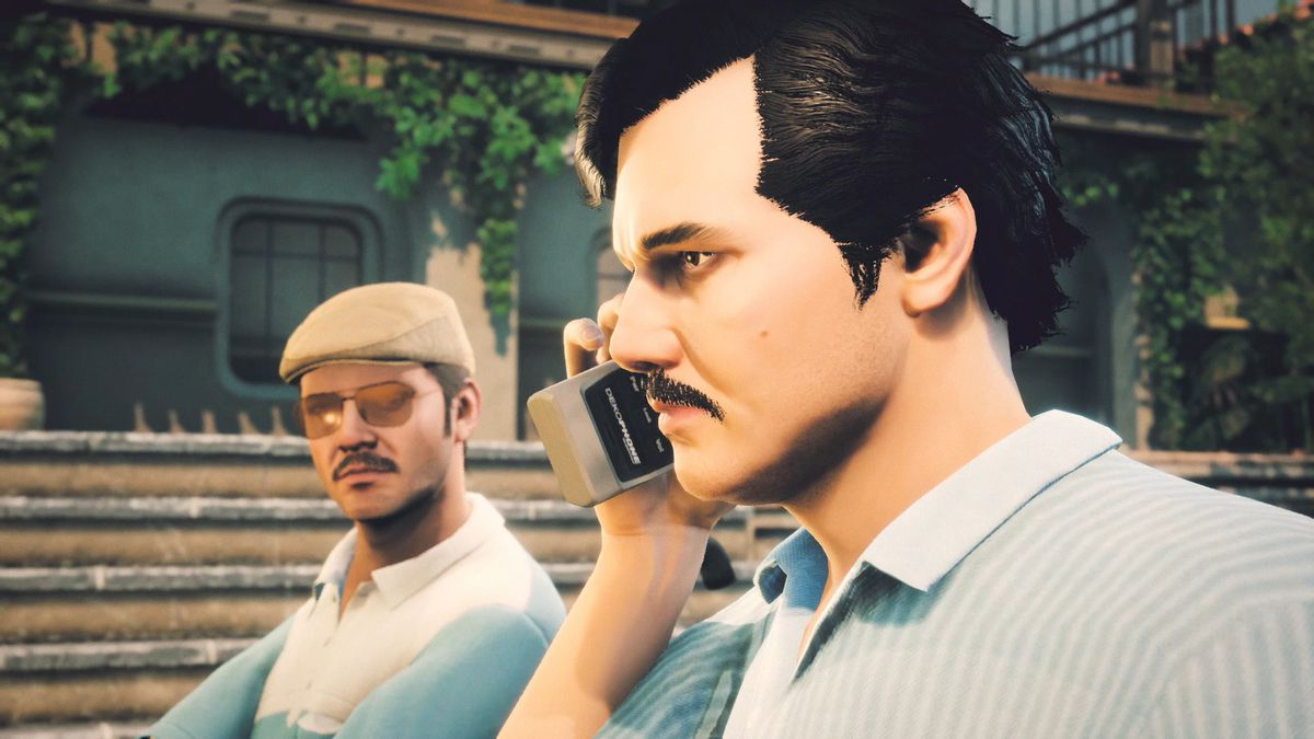 A drug dealer talks on a 1980s-era mobile phone as his henchman looks on.
