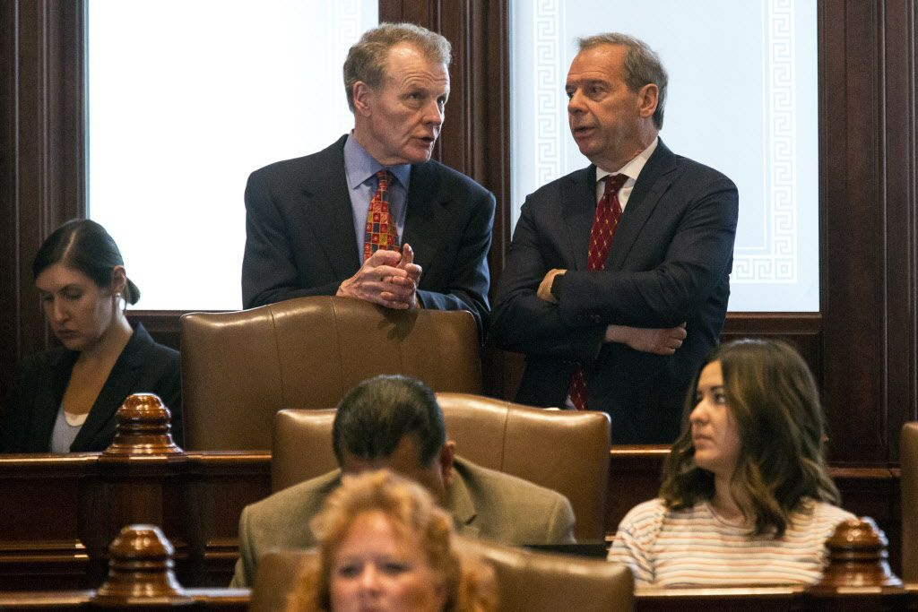 House Speaker Michael Madigan, D-Chicago, left, and Senate President John Cullerton, D-Chicago, talk on the Senate floor Tuesday, July 4, 2017, at the Capitol in Springfield, Ill. File Photo. (Rich Saal/The State Journal-Register via AP)