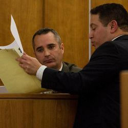 Lt. Mike Brower, left, reviews evidence presented to him while testifying on the first day of Martin Bond's trial in 4th District Court in American Fork Wednesday, Jan. 16, 2013. Bond is accused of killing former BYU professor Kay Mortensen in November 2009.