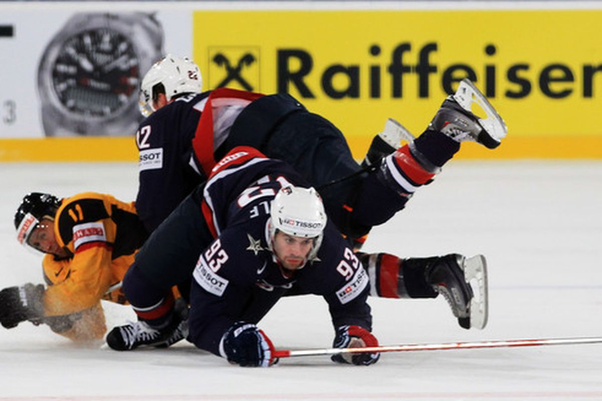 Team USA doesn't want to keep falling over themselves, they need a win today vs. Denmark.  (Photo by Martin Rose/Bongarts/Getty Images)