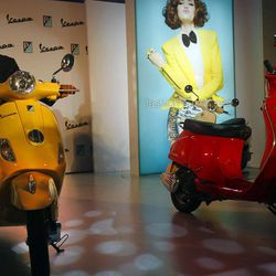 Chairman and Managing Director of Piaggio Vehicles Limited India Ravi Chopra poses on a Vespa scooter during its launch in Mumbai, India, Thursday, April 26, 2012. The Italian company hopes to carve out a market for luxury scooters in one of the most cost-conscious markets in the world. The Vespa LX will cost around 66,661 rupees ($1,282) in India, a 40 percent premium to most scooters, but still the lowest sticker price in the world.