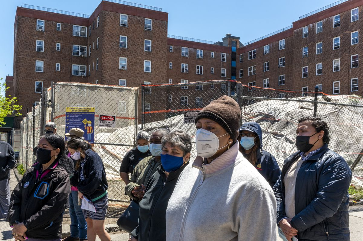 A group of Red Hook Houses residents wait to speak about the conditions they are forced to live in.