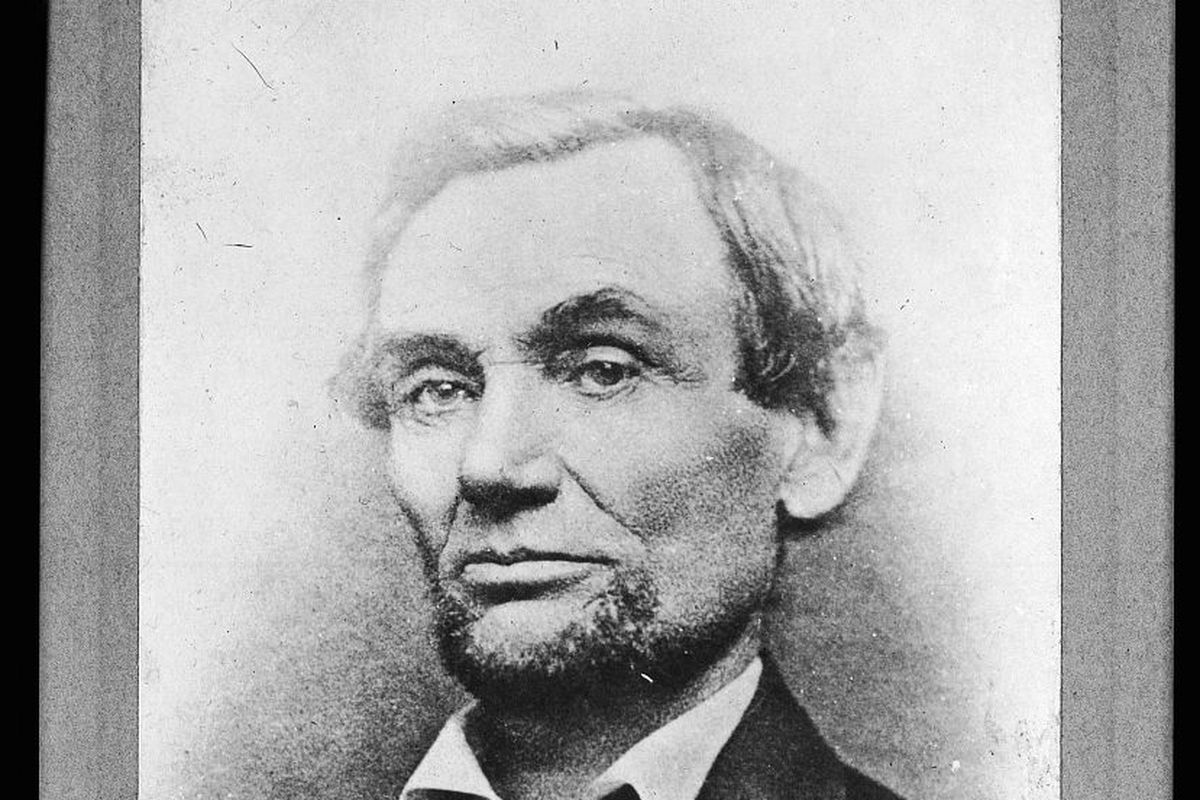 A faded black and white photograph of president-elect Abraham Lincoln, taken in November 1860.