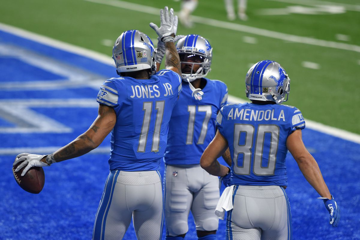 Marvin Jones #11, Marvin Hall #17, and Danny Amendola #80 of the Detroit Lions react following a touchdown during their game against the Washington Football Team at Ford Field on November 15, 2020 in Detroit, Michigan.