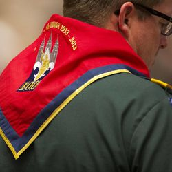 A scout leader with a neckerchief of the 100 years of scouting finds his seat as Thousands of scouts and their leaders assemble Tuesday, Oct. 29, 2013 in the Conference Center in Salt Lake City to celebrate a century of honor.