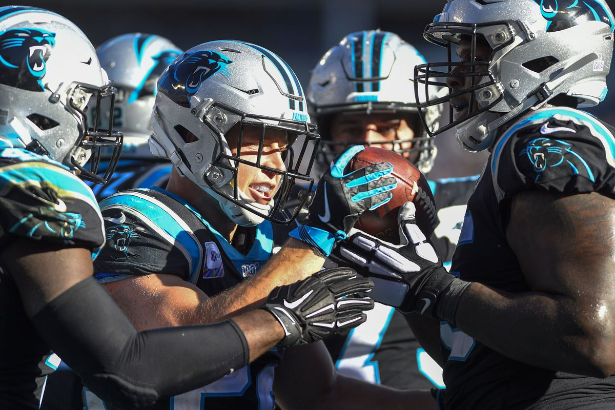 Carolina Panthers running back Christian McCaffrey celebrates with fullback Alex Armah and offensive tackle Dennis Daley after scoring a touchdown in the third quarter at Bank of America Stadium.