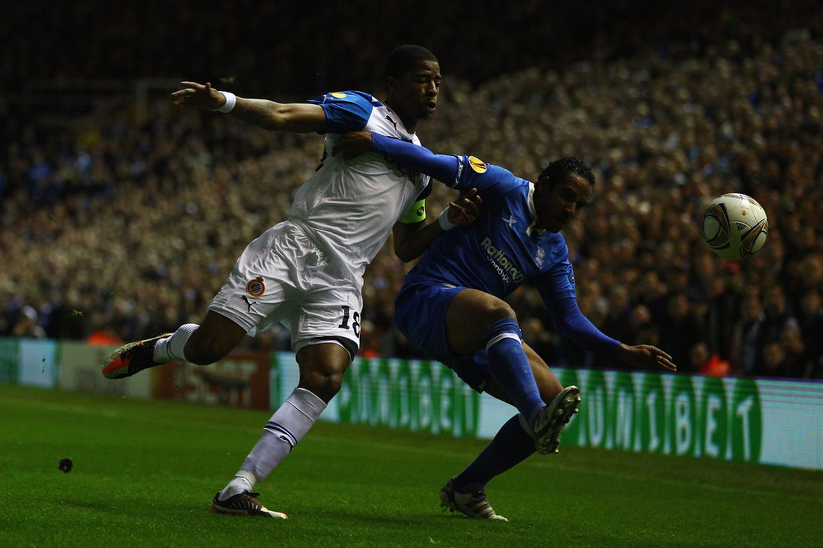Jean Emanuel Beausejour Coliqueo of Birmingham holds off Ryan Donk of Brugge during the UEFA Europa League group H match between Birmingham City FC and Club Brugge KV.