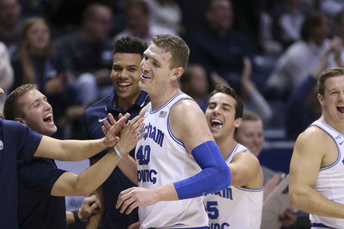 Brigham Young Cougars forward Kolby Lee (40) is congratulated after leaving the game against the San Diego Toreros with the team's high score in Provo on Thursday, Jan. 16, 2020. BYU won 93-70.