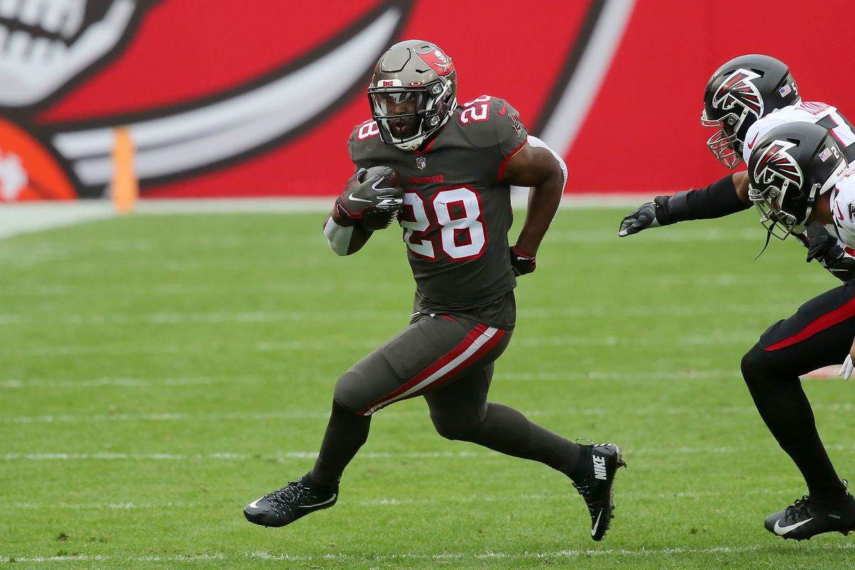 Buccaneers runningback Leonard Fournette (28) runs with the ball during the regular season game between the Atlanta Falcons and the Tampa Bay Buccaneers on January 03, 2021 at Raymond James Stadium in Tampa, Florida.
