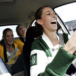 Addy Marsh, 17, front, texts while Virginia Belt, 15, left, and Aimee Morris, 15, yell at her as she drives through an obstacle course at Kearns High Tuesday.