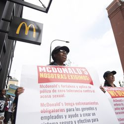 Protesters carry a list of demands. | Colin Boyle/Sun-Times