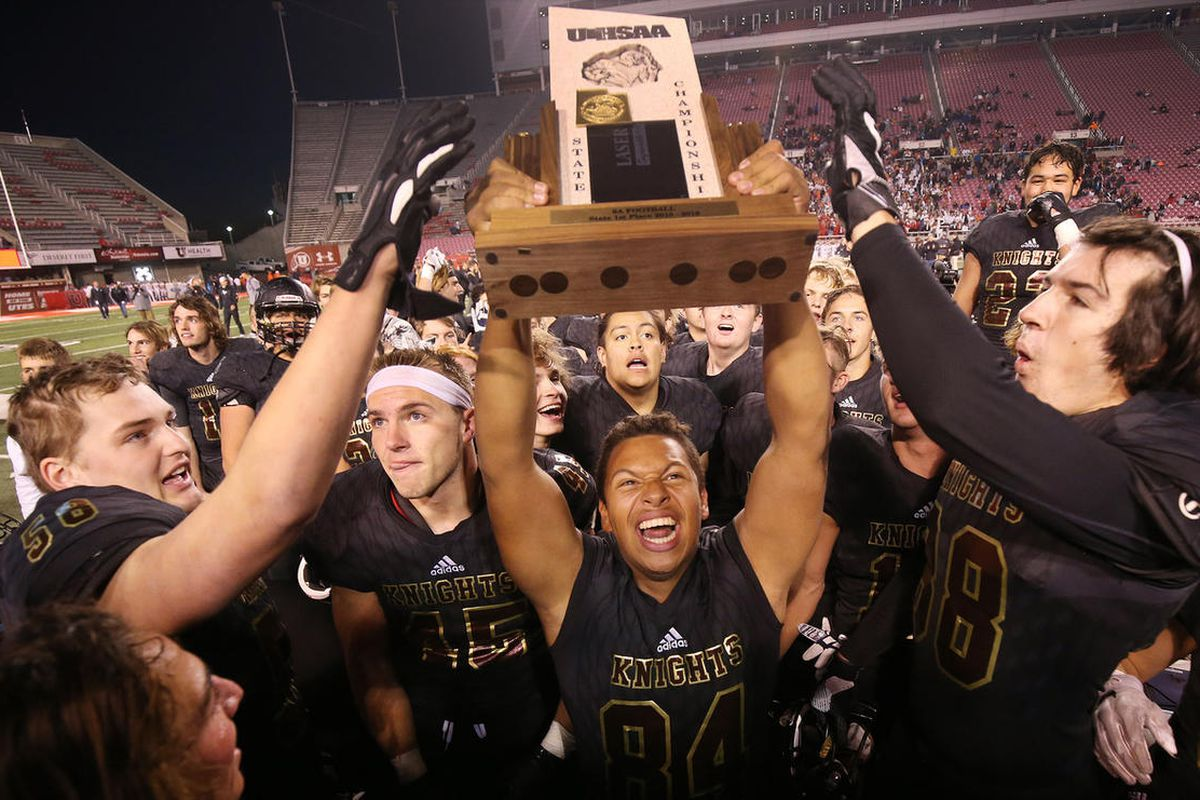 Lone Peak celebrate their won over American Fork  during the 6A championship game in Salt Lake City on Friday, Nov. 16, 2018. Lone Peak  won 34-29.
