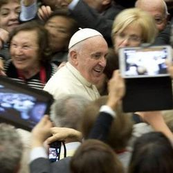 Pope Francis arrives for a special audience he held for members of Catholic medical associations, in the Paul VI hall, at the Vatican, Saturday, Nov. 15, 2014.