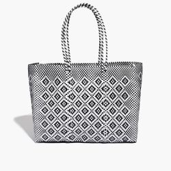 Handwoven in Mexico, this extra-large tote features handles long enough to sling over your shoulder, and the plastic material means easy clean up.