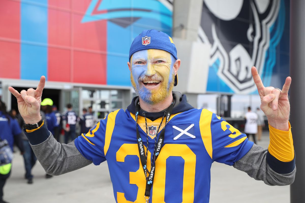 Los Angeles Rams fan Chis Fellowes of Scotland poses outside Mercedes-Benz Stadium before Super Bowl LIII, Feb. 3, 2019.