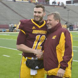 Quinten Dormady and Jim McElwain shake hands and share a smile during Senior Day ceremonies.