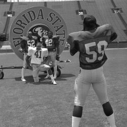 1985-John Eaford # 52, Cletis Jones # 42 and Ed Clark # 41 pose for Keith Carter # 59 - Tallahassee, Florida.