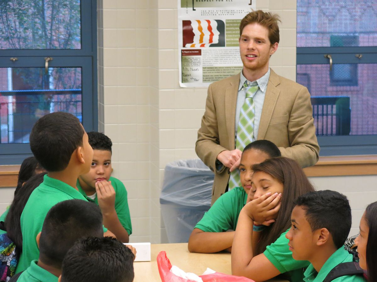 Kyle Brillante, principal at the Highbridge Green School in the Bronx, talks with students on the first day of school.