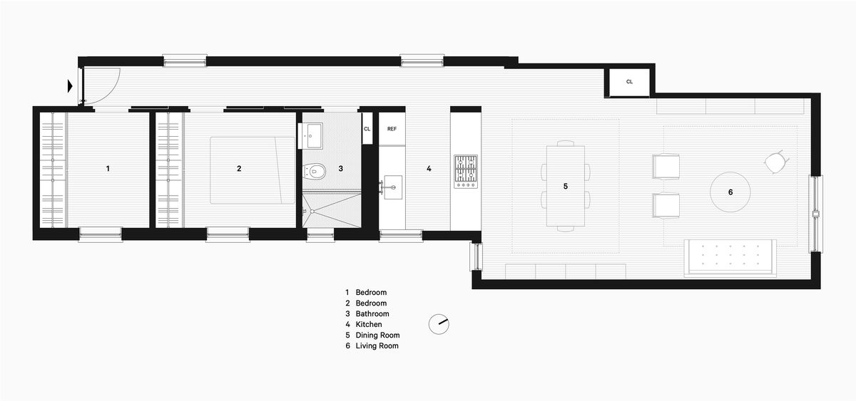 A floorplan showing a long hallway with two bedrooms, a bathroom, and kitchen, opening up to a large dining and living area.