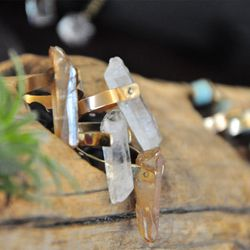 """<a href=""""http://pangeabyk.bigcartel.com/product/crystal-quartz-ring""""target=""""_blank"""">Pangea by K</a> (Table #T71)"""