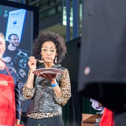 Carla Hall samples one of the dishes.