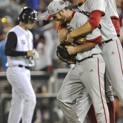 Indiana Hoosiers pitcher Joey DeNato (23) celebrates with his team after their College World Series win over Louisville.