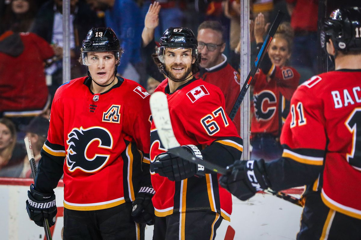 Mar 21, 2019; Calgary, Alberta, CAN; Calgary Flames left wing Matthew Tkachuk (19) celebrates his goal with teammates against the Ottawa Senators during the third period at Scotiabank Saddledome. Calgary Flames won 5-1.