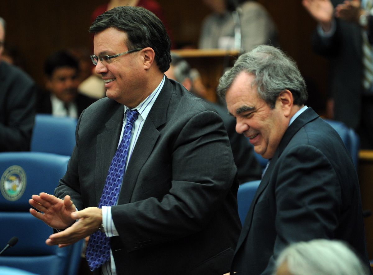 Cook County Board Commissioner Peter Silvestri, left, and Finance Committee Chairman John Daley in 2011.